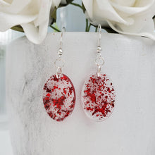 Load image into Gallery viewer, Oval Earrings, Drop Earrings, Resin Earrings, Earrings - Handmade resin oval drop earrings with red flakes.