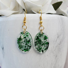 Load image into Gallery viewer, Oval Earrings, Drop Earrings, Resin Earrings, Earrings - Handmade resin oval drop earrings with green flakes.