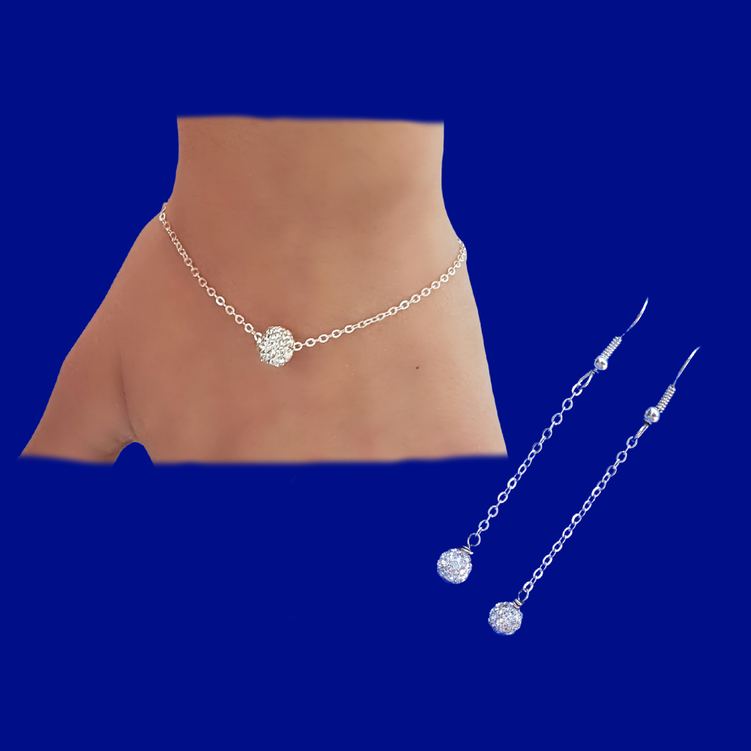 A handmade floating crystal bracelet accompanied by a pair of drop earrings.