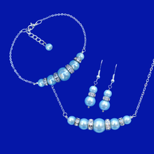 Load image into Gallery viewer, A handmade pearl and crystal bar necklace accompanied by a matching bracelet and a pair of drop earrings. light blue or custom color