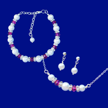 Load image into Gallery viewer, handmade pearl and swarovski crystal bar necklace accompanied by a bracelet and a pair of pearl stud earrings