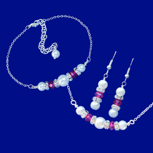 handmade pearl and swarovski crystal bar necklace accompanied by a matching bracelet and a pair of drop earrings