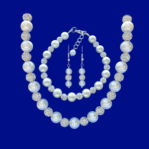 A handmade crystal and pearl necklace accompanied by a matching bracelet and drop earrings.