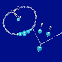 Load image into Gallery viewer, handmade pearl drop necklace accompanied by a bar bracelet and a pair of stud earrings