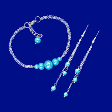 Load image into Gallery viewer, handmade pearl bar bracelet accompanied by a pair of multi-strand drop earrings