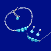 Load image into Gallery viewer, handmade pearl bar necklace accompanied by a matching bracelet and a pair of stud earrings