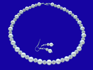A handmade pearl and crystal necklace accompanied by a pair of drop earrings.