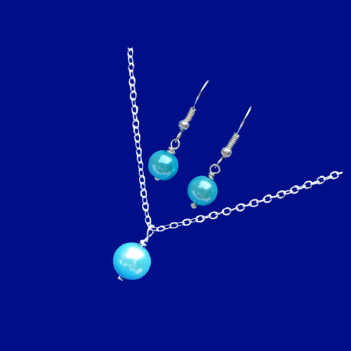 handmade drop necklace accompanied by a pair of earrings