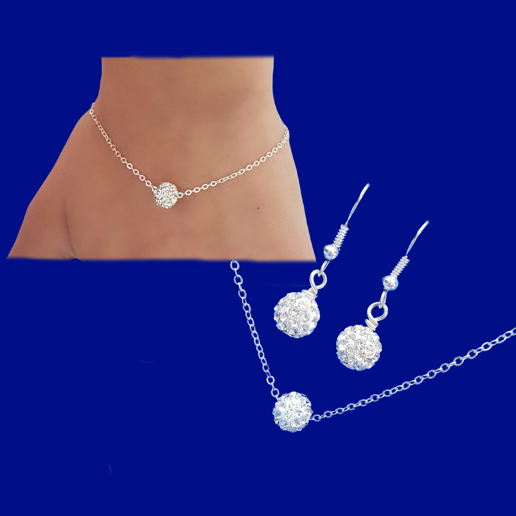handmade minimalist floating crystal necklace accompanied by a matching bracelet and a pair of earrings