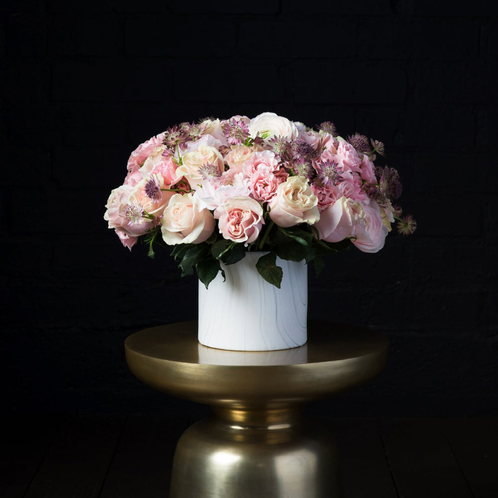 Detail of geraldine and pink mondial roses paired with hellebores.