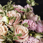 Detail of pink hyacinth, pink mondial roses, pink ranunculus, helleborus and green accents.
