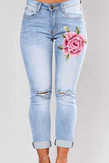 Women's light wash distressed rose patch jeans