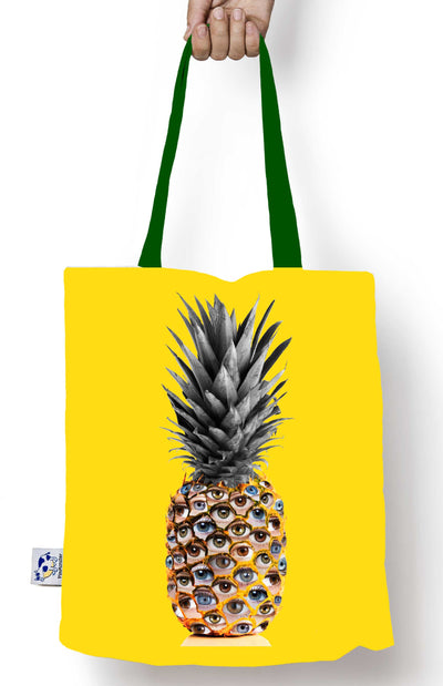 The Glance, the eyes on the pineapple tote bag