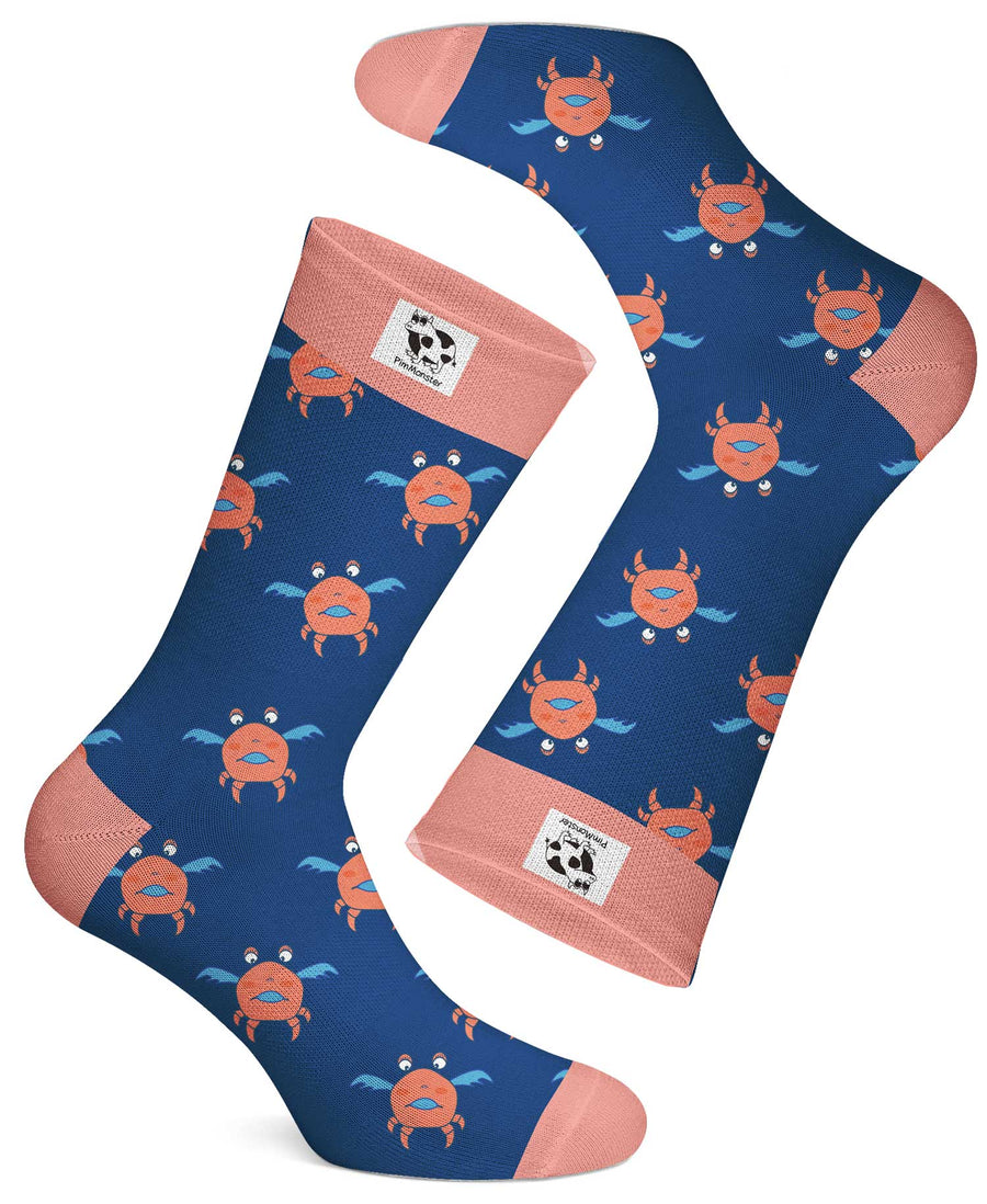 The Crabby Flier sock comes in a fresh retro blue and pink. Wouldn't it be funny if crabs can fly? Made from the finest combed cotton that will keep your feet cool and dry.