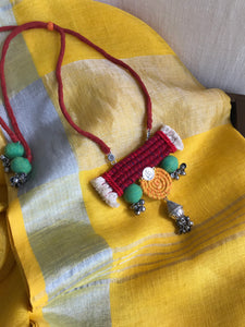 Dori necklace made with fabric and threads
