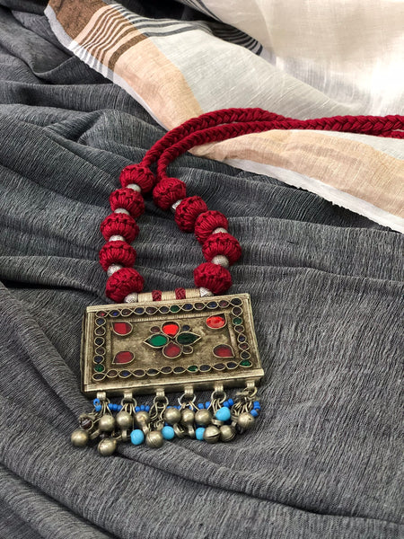 Afghani pendant in maroon threads dori