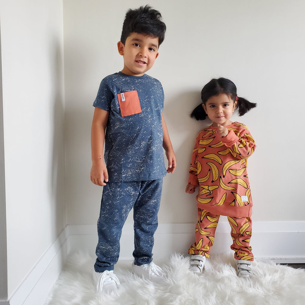 Boy wearing Indikidual splatter print harem pants. Ethically made in India with 100% organic cotton.
