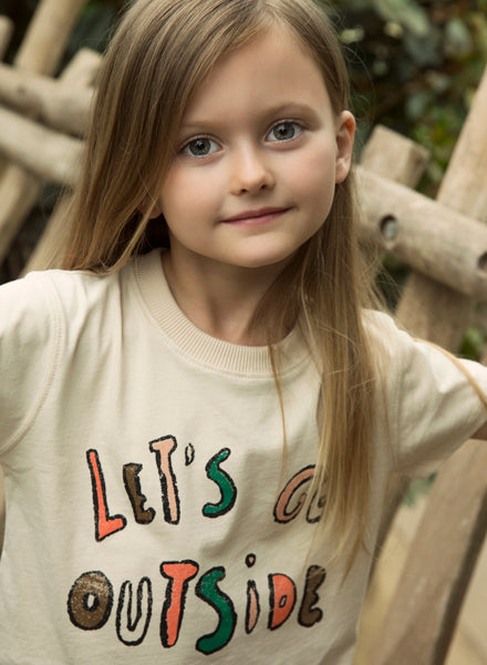 Girl wearing Ammehoela eggwhite t-shirt made ethically in the EU with 100% organic cotton. Gender neutral. Fit's true to size.