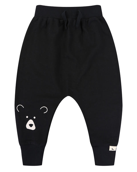 Black harem pants with bear face on the right leg. Made of 100% organic cotton.