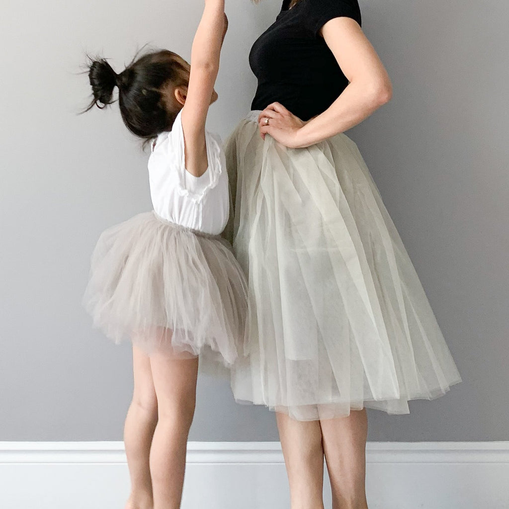 Mom and daughter wearing Bluish tulle skirts in grey.