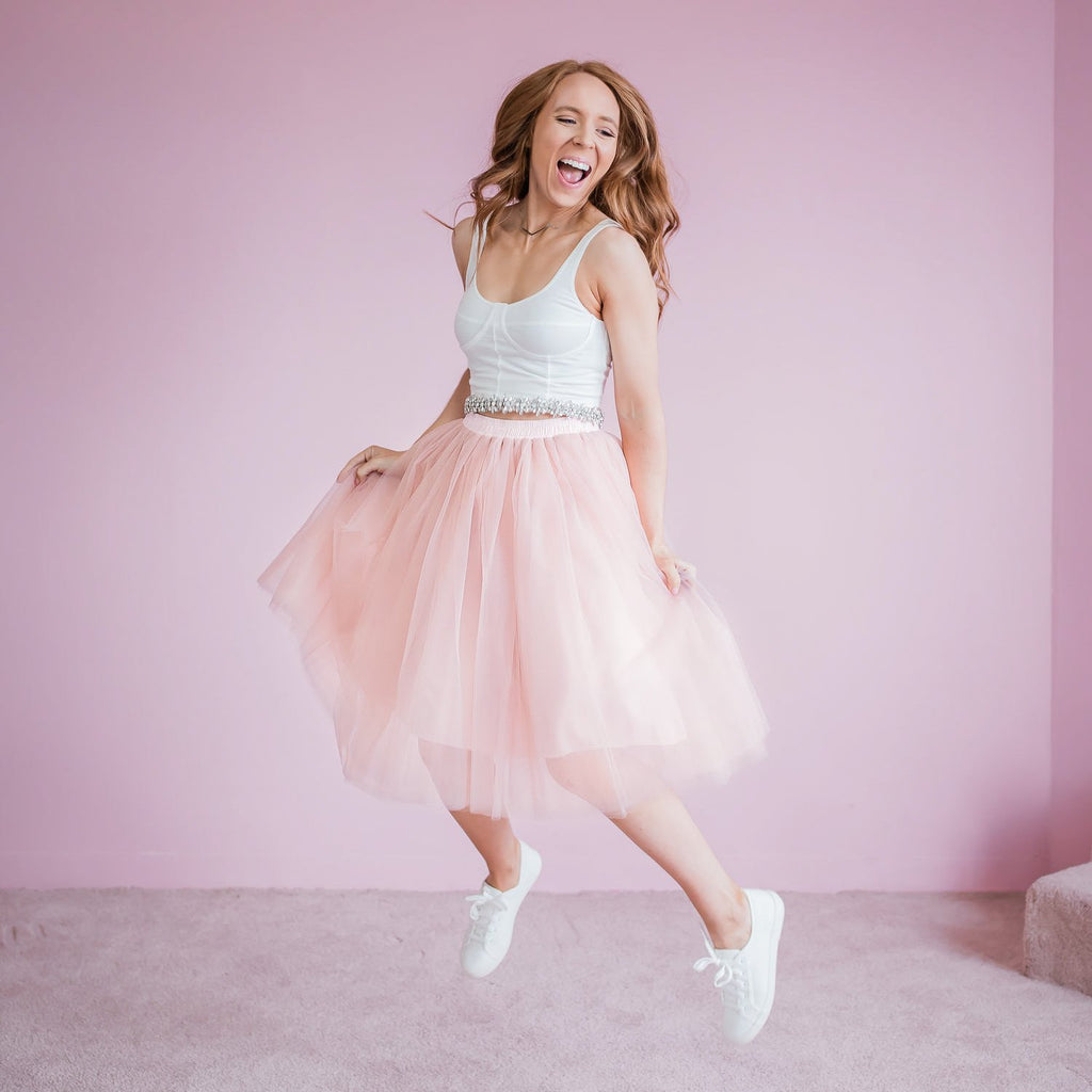 Woman wearing Bluish tulle skirt in pink.