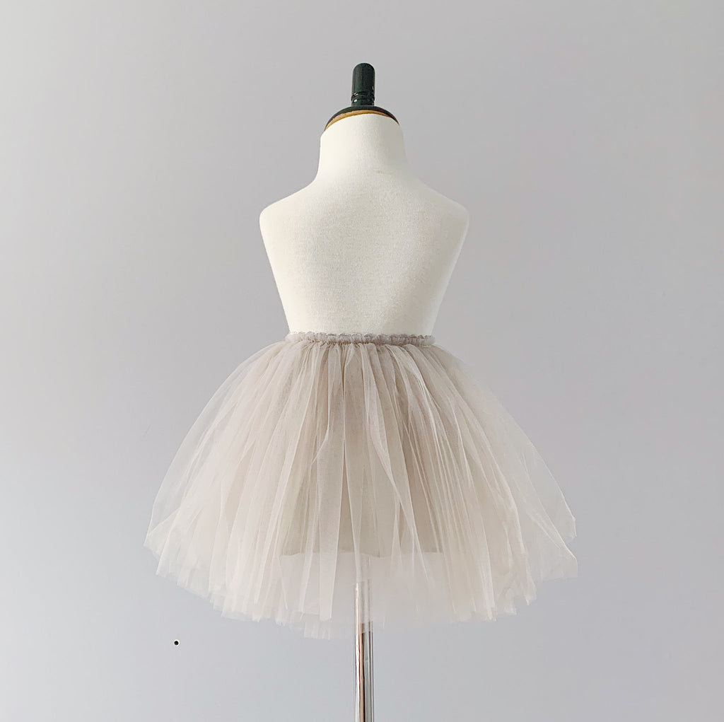 Mannequin wearing Bluish tulle skirt in grey colour.