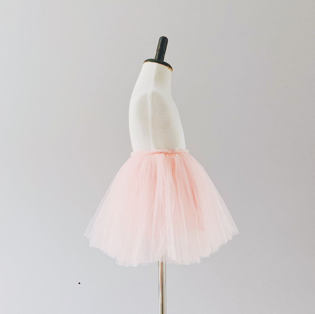 Bluish Baby Celine Tutu Skirt in pink colour. It is made with three layers of silky soft tulle, a layer of cotton lining, and a velvety waistband that hugs your child's waist. Ethically made in China, and the finishing touches are done by hand in Toronto, Canada.