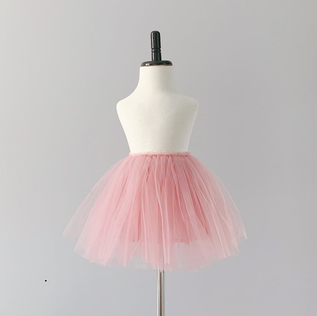 Bluish Baby Celine Tutu Skirt in rose colour. It is made with three layers of silky soft tulle, a layer of cotton lining, and a velvety waistband that hugs your child's waist. Ethically made in China, and the finishing touches are done by hand in Toronto, Canada.