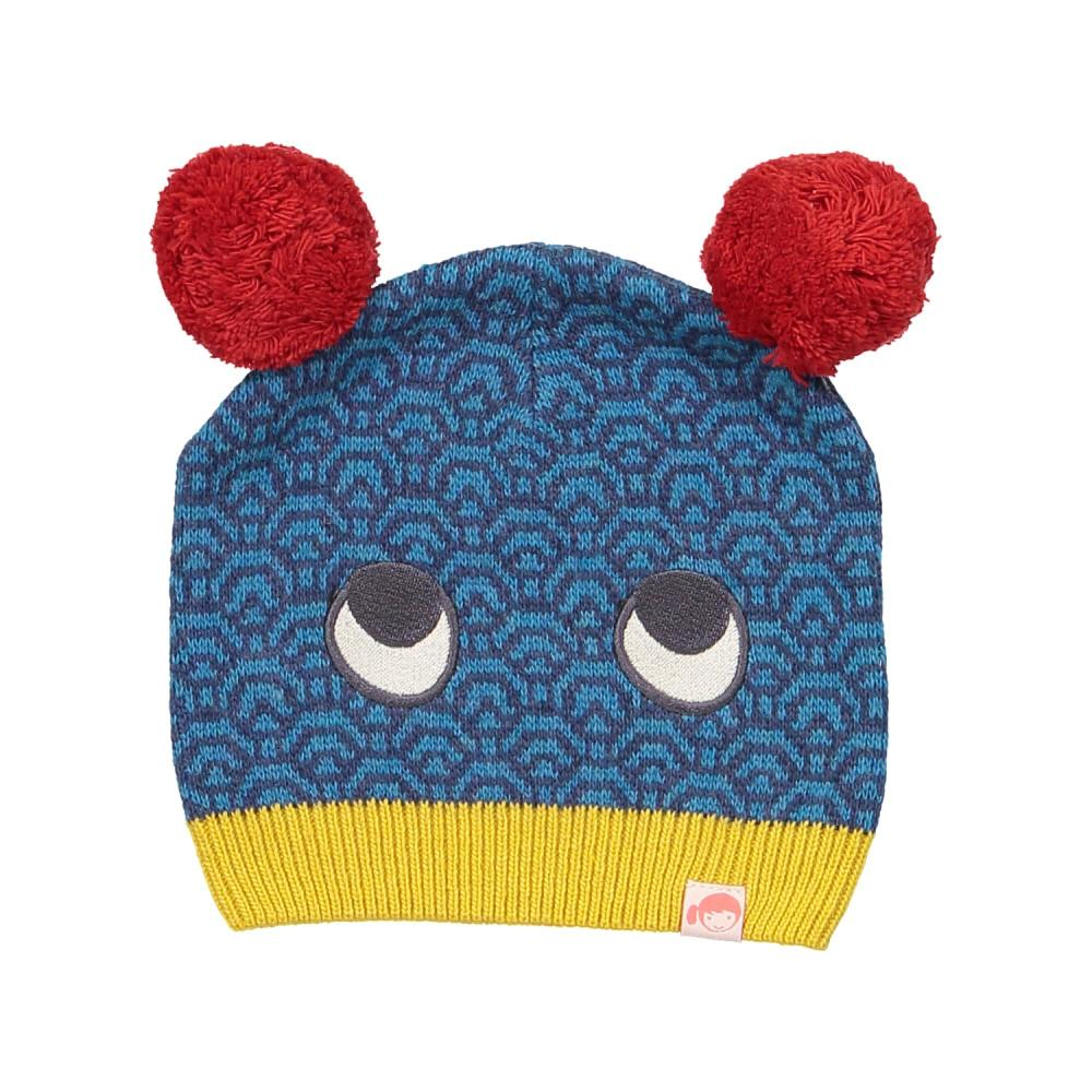 Indigo blue beanie with two pompoms on the side and two eyes at the front. Made with Cashmere and Wool.