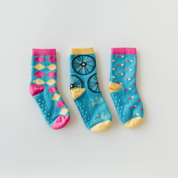 Mismatched socks for kids, in funky colours, made with organic cotton with grips on the bottom.