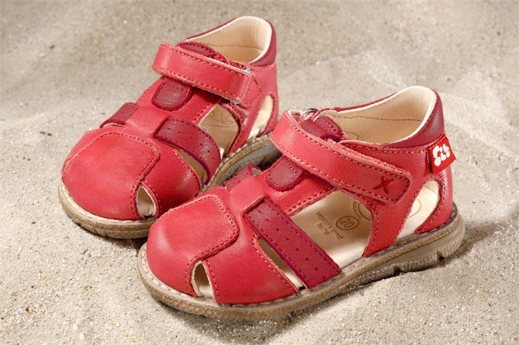 Kids red sandals with velcro ethically made of eco-friendly materials.