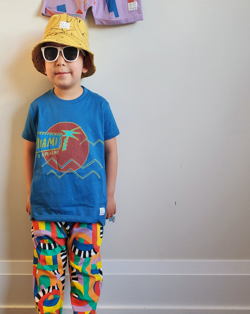 Boy wearing Indikidual Banana Print Bucket Hat made ethically in India with organic cotton.