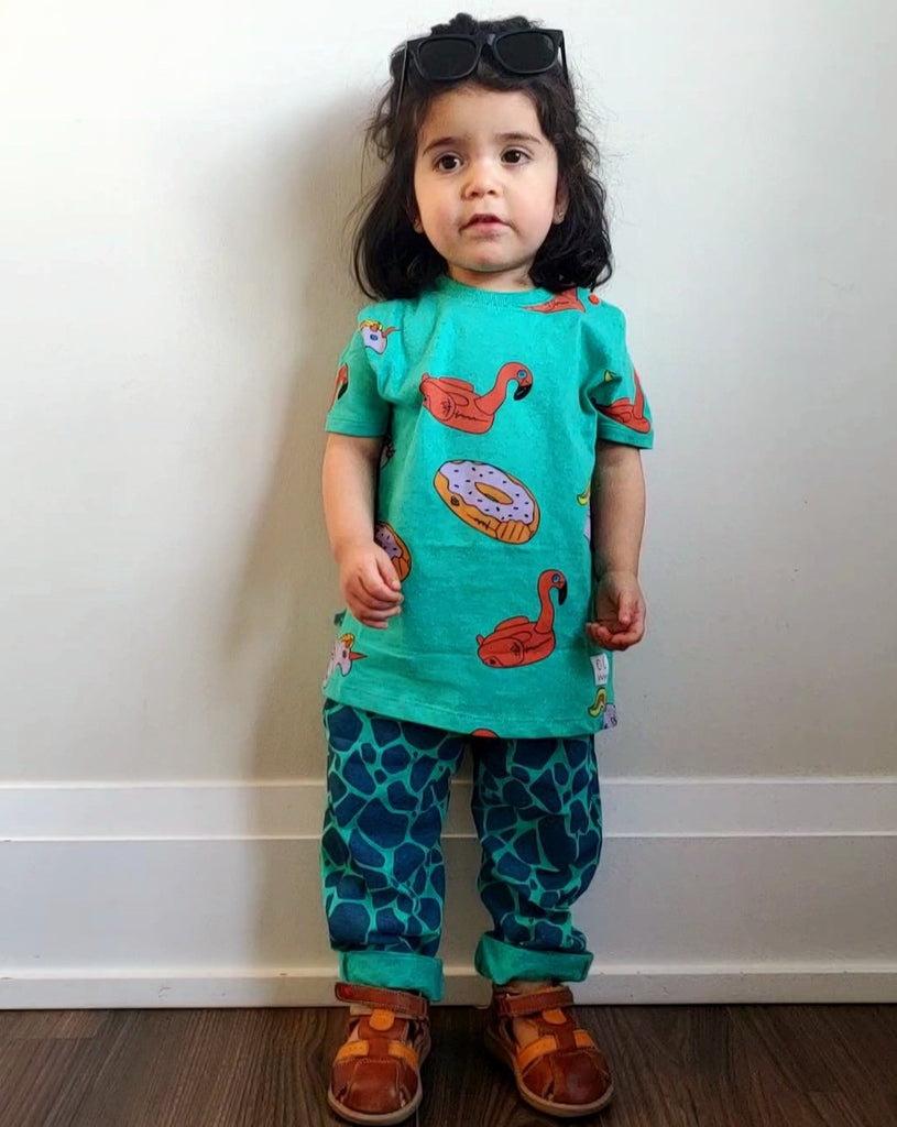Girl wearing Individual turtle print harem pants made ethically in India with 100% organic cotton.
