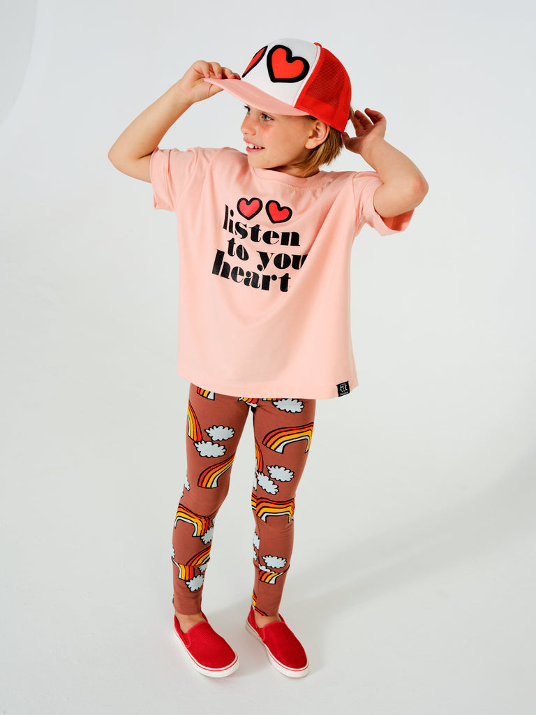 "Girl wearing Kukukid ""listen to your heart"" t-shirt in pink. Ethically made in Poland."