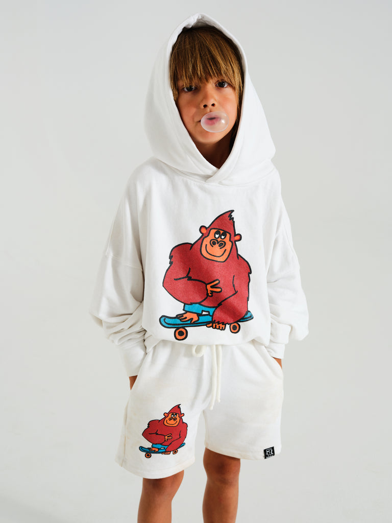 Kukukid white oversized hoodie with a monkey print at the front. Ethically made in Poland.
