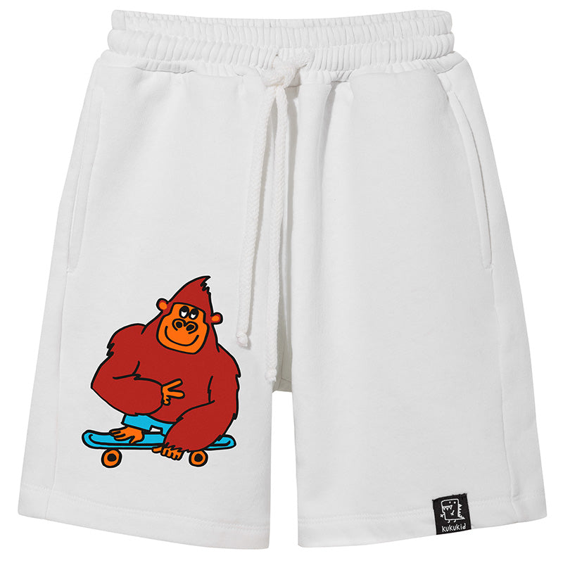 Kukukid white Monkey Pocket Shorts. Ethically made in Poland.