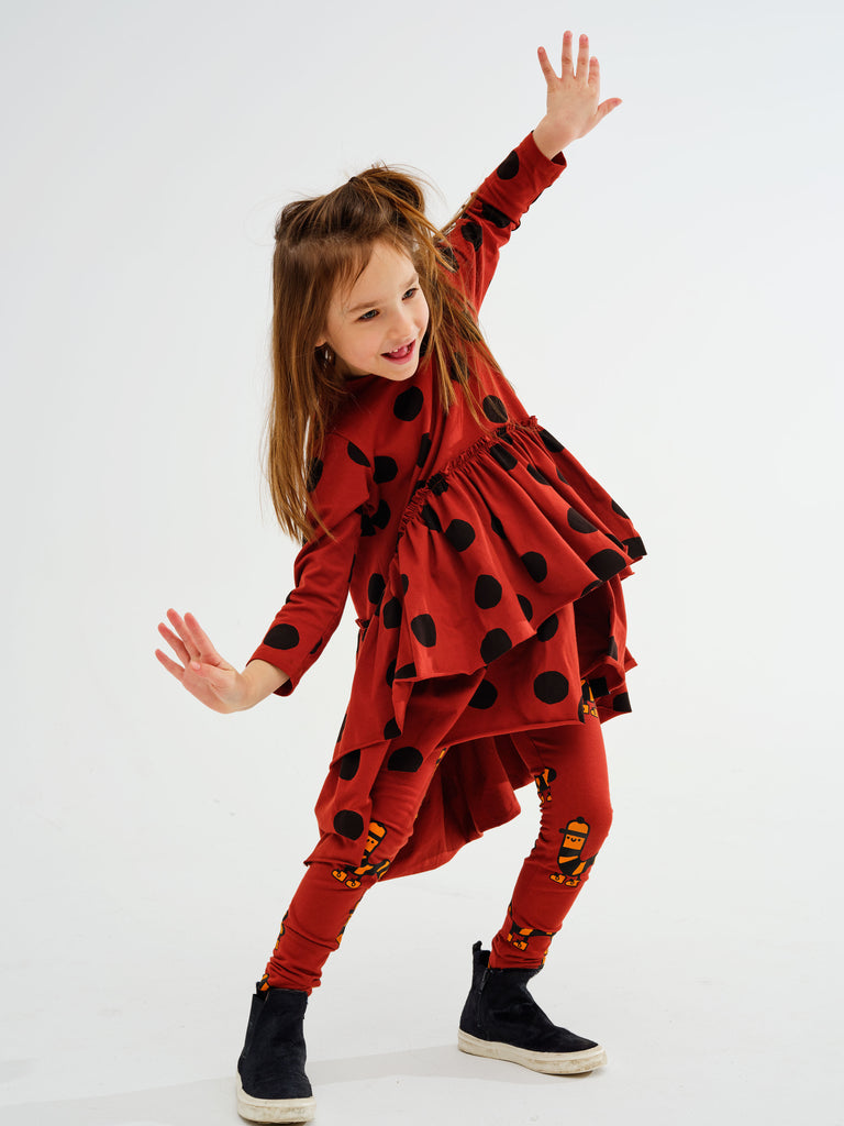 Girl wearing Kukukid dancing dress. Made ethically in Poland. Composed of 95% cotton, 5% spandex certified OEKO TEX STANDARD.