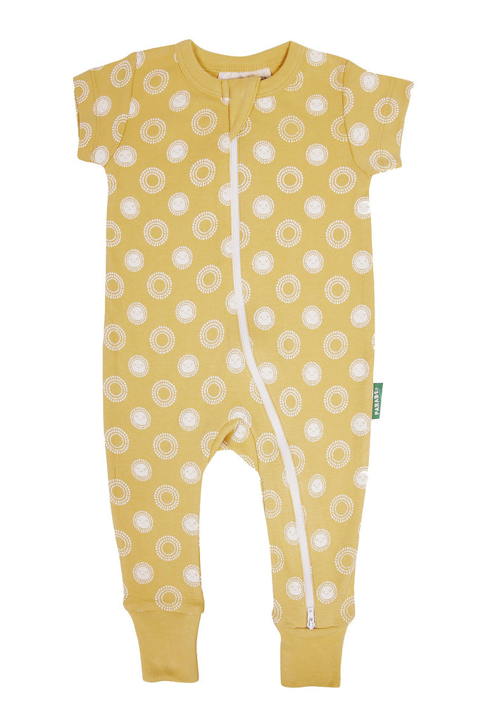 Two-way zip romper, ethically made in India with GOTS certified cotton. Yellow with sunshine print. Short sleeve.