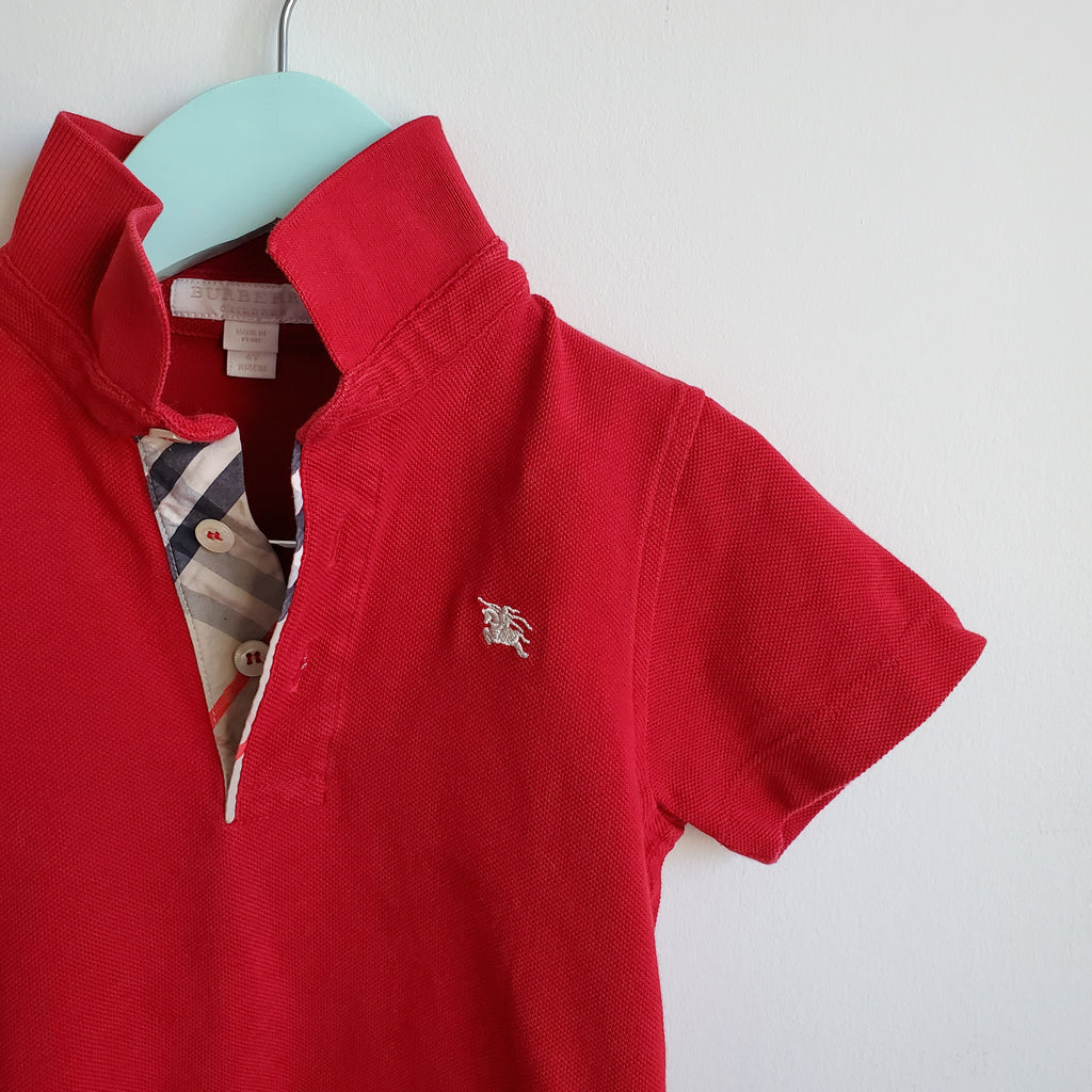 Preloved and authentic red Burberry polo, short sleeve is in excellent condition.