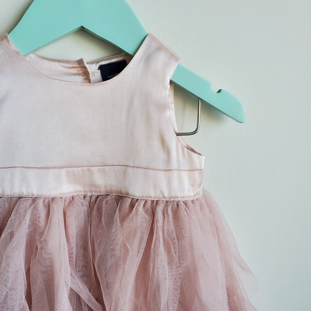 Super cute sleeveless tutu dress; top is skin. Colour is pink blush. Good condition.