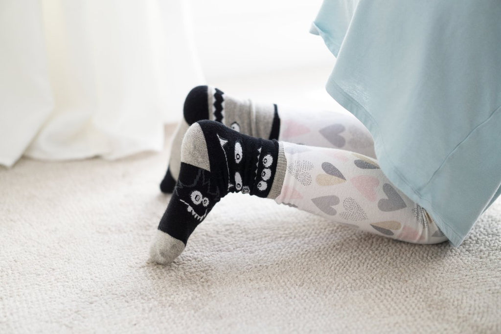 Q for Quinn organic monster socks. Made from certified organic combed cotton with seamless toes and rubber grips (for maximum anti-slip support). This set features 3 pairs of socks,