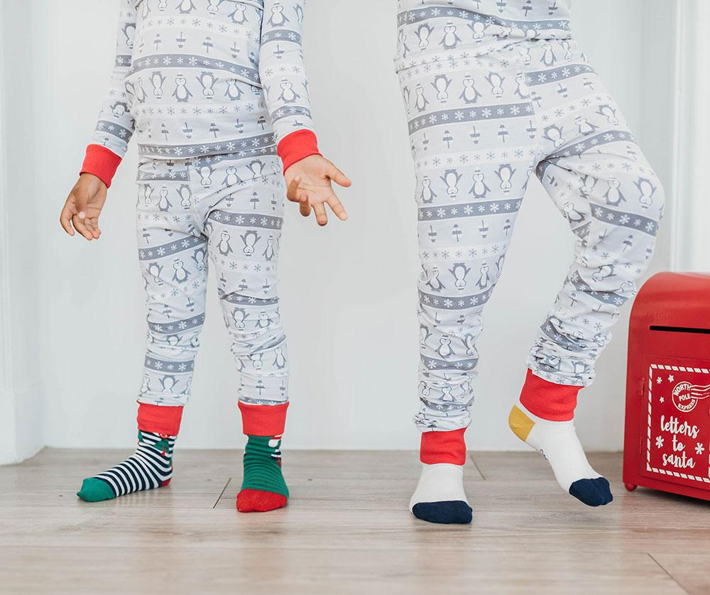 Kid wearing Q for Quinn Christmas socks. Made from Certified Organic GOTS cotton  Free from BPA, Parabens, Formaldehyde, Lead and other toxins commonly found in children's clothing and socks.
