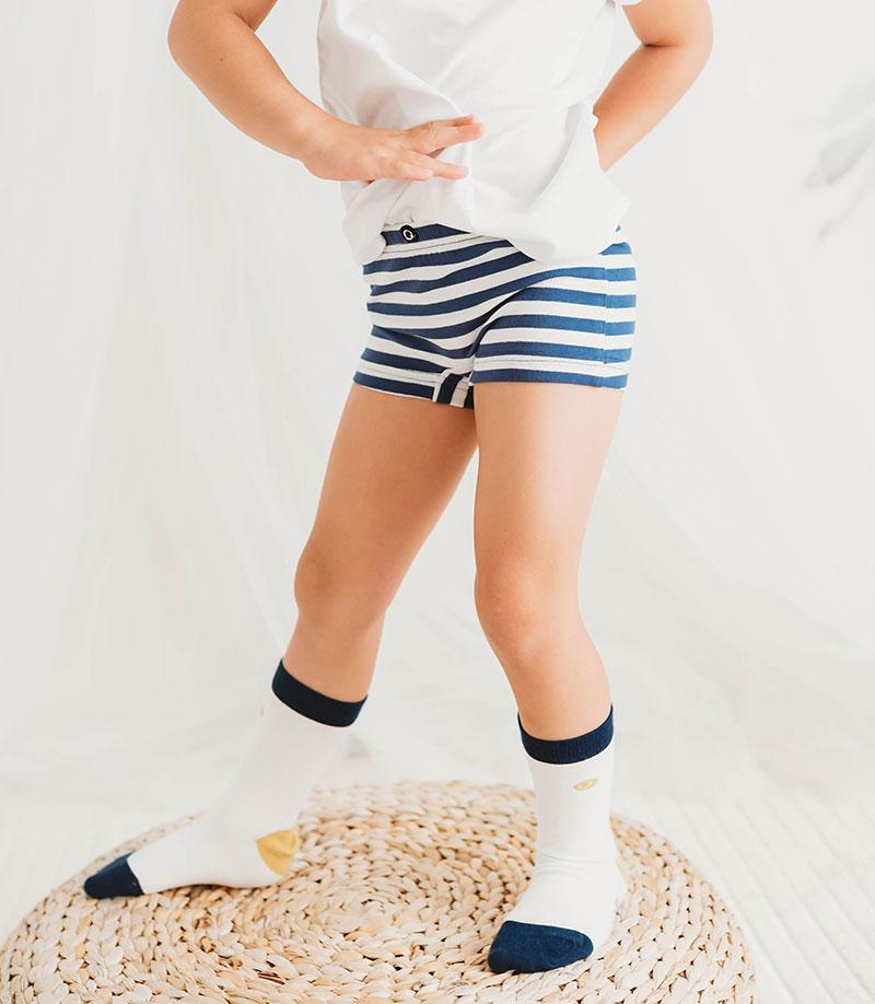 Q for Quinn girls boxer briefs made with organic cotton. Pack of two, one navy blue and one with stripes. Ethically made in India.