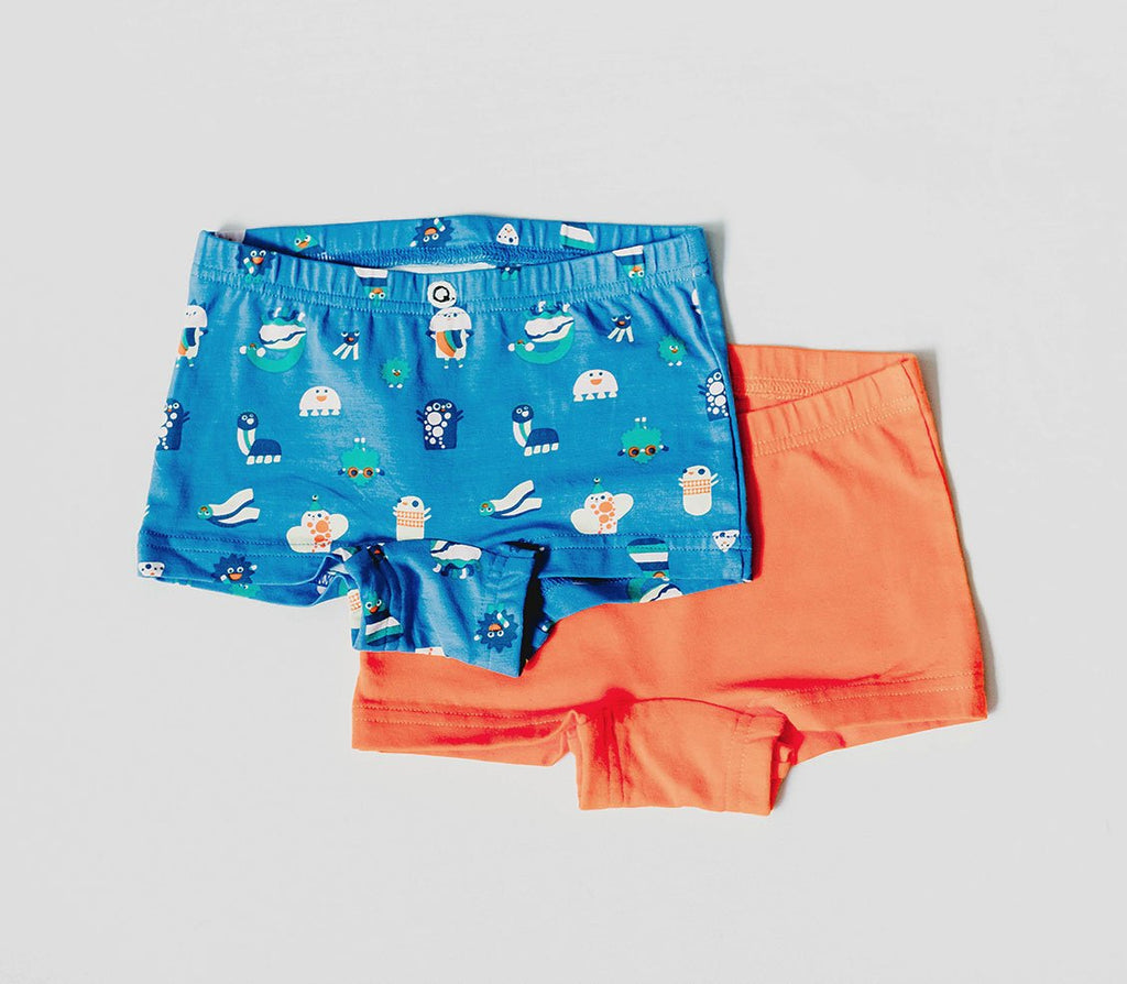 Q for Quinn organic underwear for girls. Made with GOTS certified organic cotton. Two pair pack, one blue with funny creatures print, and in solid orange.