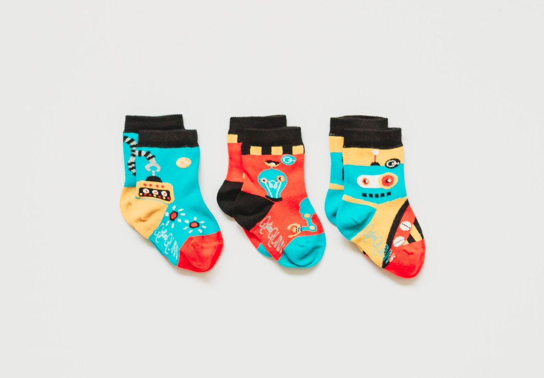 Mismatched Robot socks made with organic cotton. Funky design and colours.