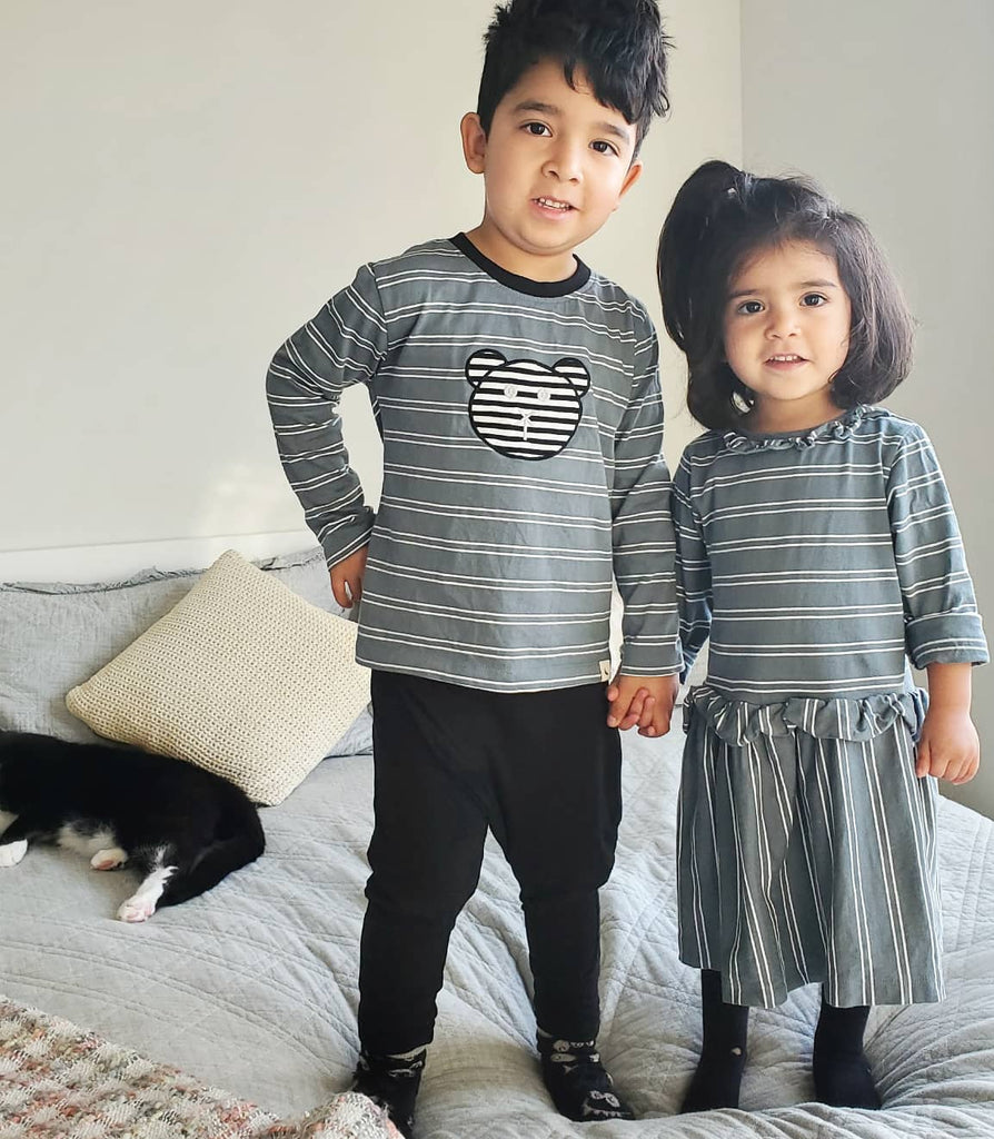 Boy and girl wearing Turtledove London jersey long sleeve top and ruffle dress. Made of 100% GOTS certified organic cotton, and ethically made in India.