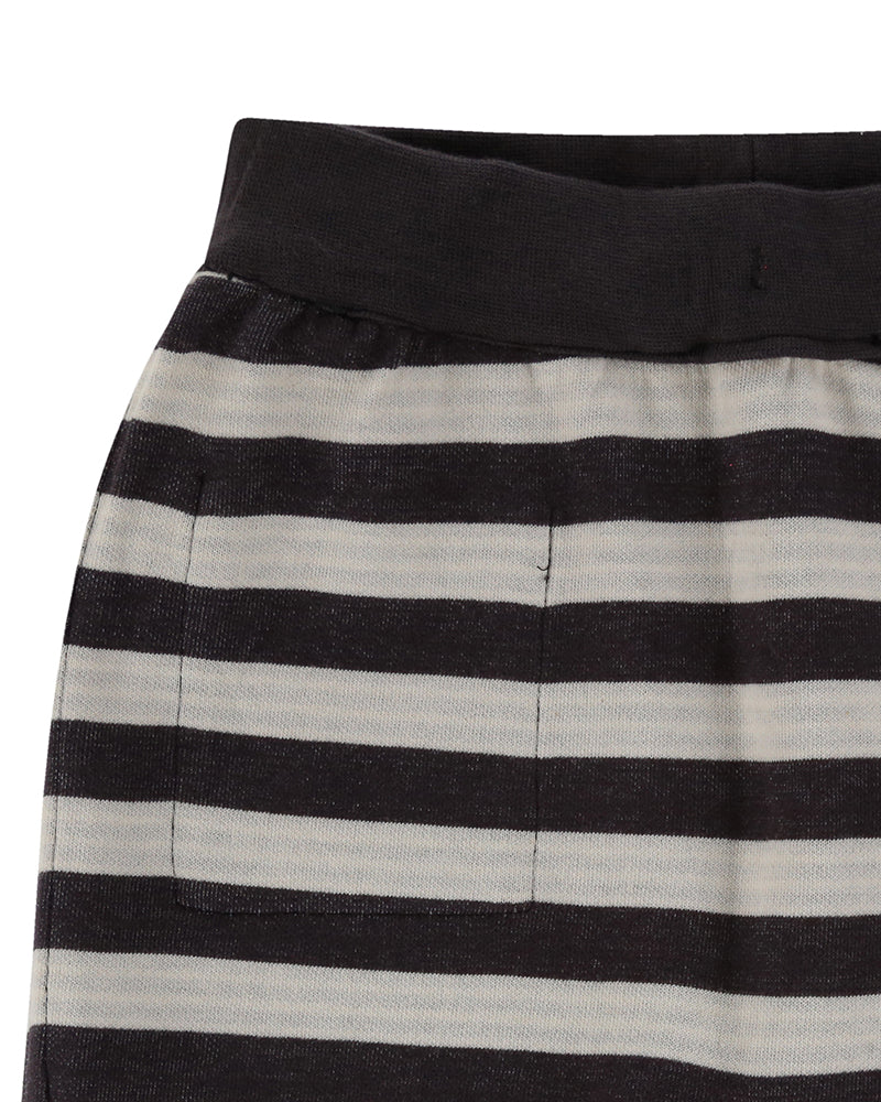 Turtledove London Reversible Jersey Stripe Shorts. Made ethically in India with 100% GOTS certified organic cotton. Features one front pocket on one of the sides. Close up of side two.