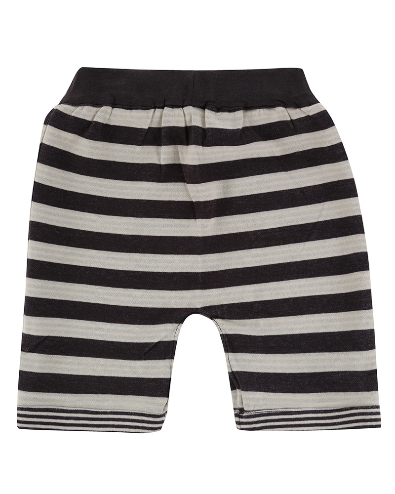 Turtledove London Reversible Jersey Stripe Shorts. Made ethically in India with 100% GOTS certified organic cotton. Features one front pocket on one of the sides. Back of side 2.
