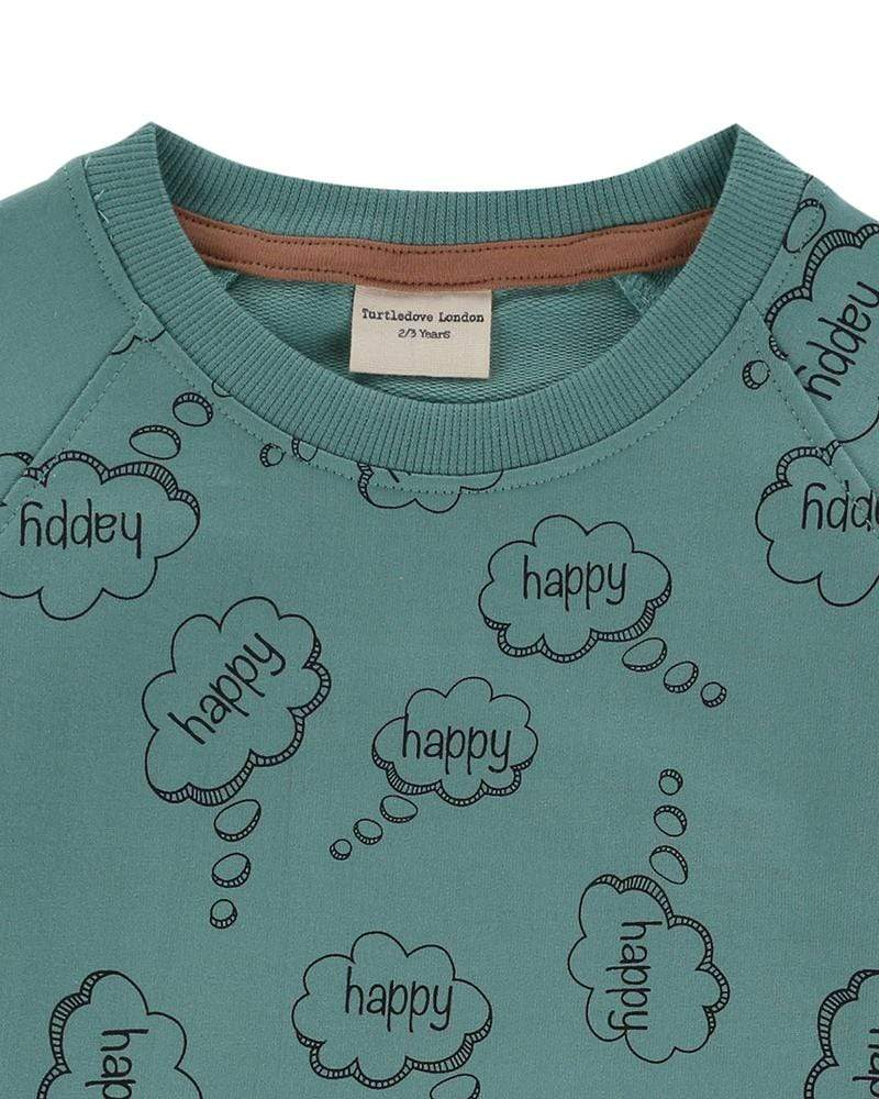 Turtledove London Happy thoughts green sweatshirt. Ade with GOTS certified cotton. Gender neutral kids clothes. Close up 1