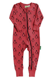 Two-way zipper romper, in red with black penguins. Made of 100% organic cotton.